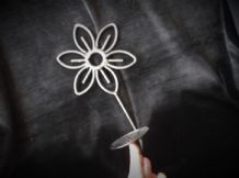 BLACK WROUGHT IRON ? WALL HANGING CANDLE HOLDER IN DAISY SHAPE